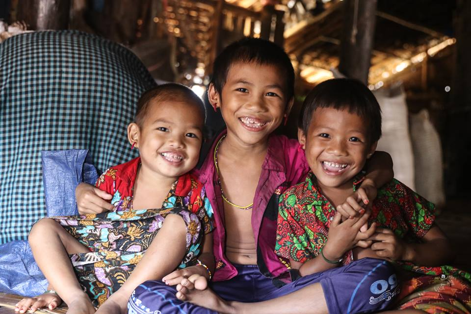 Three Asian children smiling