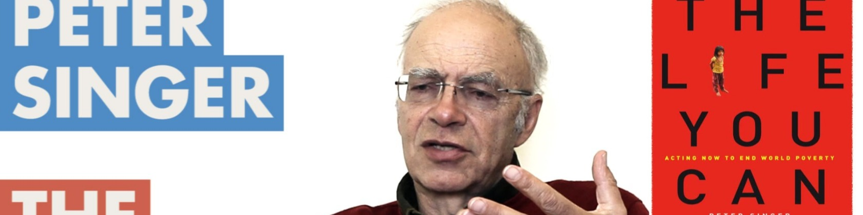 Peter Singer lecturing. The Life You Can Save book is to his right.